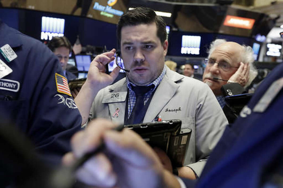 Traders Joseph Lawler, left, and Peter Tuchman work on the floor of the New York Stock Exchange, Monday, Oct. 24, 2016. Stocks are opening higher on Wall Street as traders looked over a big batch of corporate deals. (AP Photo/Richard Drew)