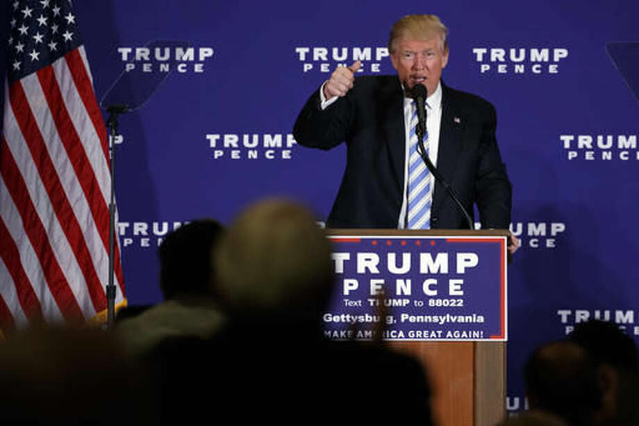 "In this Oct. 22, 2016, photo, Republican presidential candidate Donald Trump delivers a speech during a campaign event in Gettysburg, Pa. Trump has warned for weeks of a ""rigged"" election, telling his supports to watch out for large-scale voter fraud, despite a lack of evidence that it exists. In the past few days, Trump has specifically raised concerns about people fraudulently voting using the names of dead people and cited research showing 1.8 million deceased people are still listed on state voter rolls.(AP Photo/ Evan Vucci)"