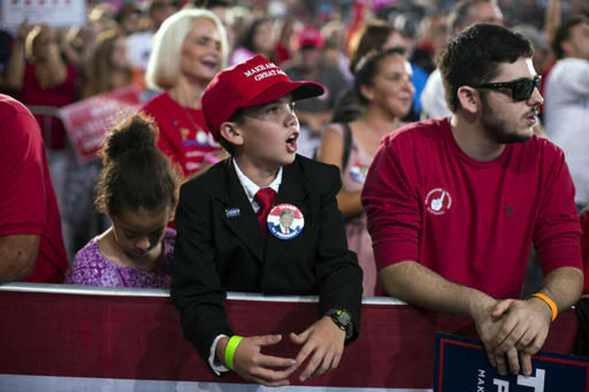 Nick Michelini of Tampa, Fla., listen as Republican presidential candidate Donald Trump speaks during a campaign rally, Monday, Oct. 24, 2016, in Tampa, Fla. (AP Photo/ Evan Vucci)