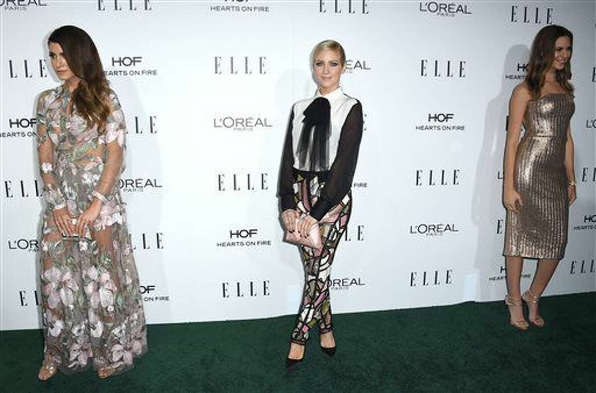 Nikki Reed, from left, Brittany Snow and Odette Annable arrive at the 23rd annual ELLE Women in Hollywood Awards at the Four Season Hotel on Monday, Oct. 24, 2016, in Los Angeles. (Photo by Jordan Strauss/Invision/AP)