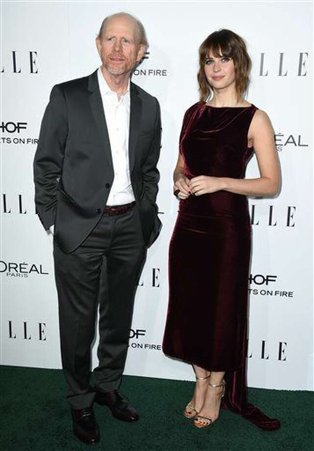 Ron Howard, left, and Felicity Jones arrive at the 23rd annual ELLE Women in Hollywood Awards at the Four Season Hotel on Monday, Oct. 24, 2016, in Los Angeles. (Photo by Jordan Strauss/Invision/AP)