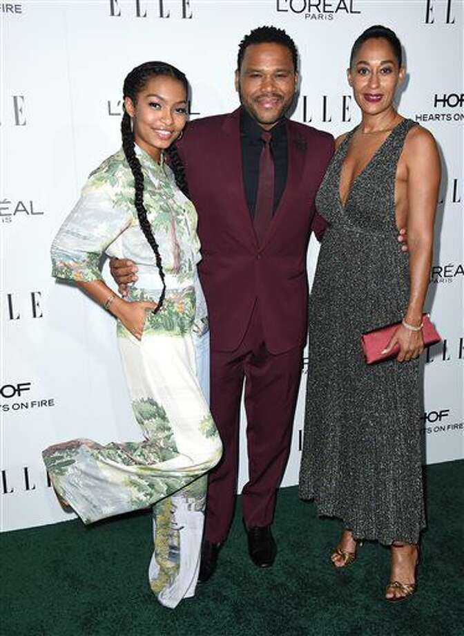 Yara Shahidi, from left, Anthony Anderson and Tracee Ellis Ross arrive at the 23rd annual ELLE Women in Hollywood Awards at the Four Season Hotel on Monday, Oct. 24, 2016, in Los Angeles. (Photo by Jordan Strauss/Invision/AP)