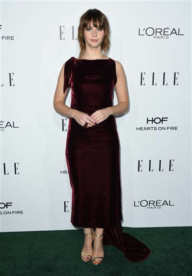 Felicity Jones arrives at the 23rd annual ELLE Women in Hollywood Awards at the Four Season Hotel on Monday, Oct. 24, 2016, in Los Angeles. (Photo by Jordan Strauss/Invision/AP)