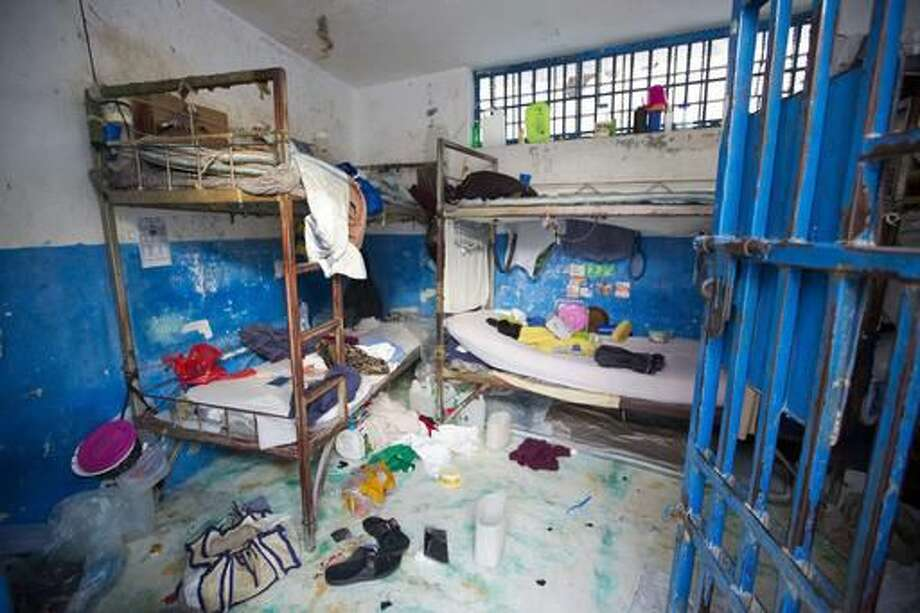 A prison cell is empty after inmates escaped from the Civil Prison in the coastal town of Arcahaiea, Haiti, Saturday, Oct. 22, 2016. Over 100 inmates escaped after they overpowered guards who were escorting them to a bathing area. (AP Photo/Dieu Nalio Chery)
