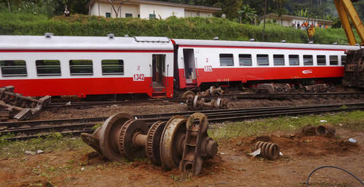 Parts of a derailed train in Eseka, Cameroon, Saturday, Oct. 22, 2016. Rescue workers dug through the rubble Saturday in search of more injured and dead after a train traveling between two major cities in Cameroon derailed in Eseka, killing scores of people, according to rescue workers and hospital staff. (AP Photo/Joel Kouam)