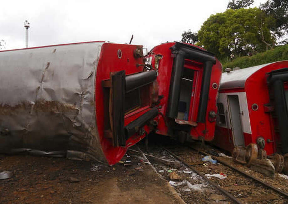 A derailed train with coaches on their sides in Eseka, Cameroon, Saturday, Oct. 22, 2016. Rescue workers dug through the rubble Saturday in search of more injured and dead after a train traveling between two major cities in Cameroon derailed in Eseka, killing at scores of people, said rescue workers and hospital staff. (AP Photo/Joel Kouam)