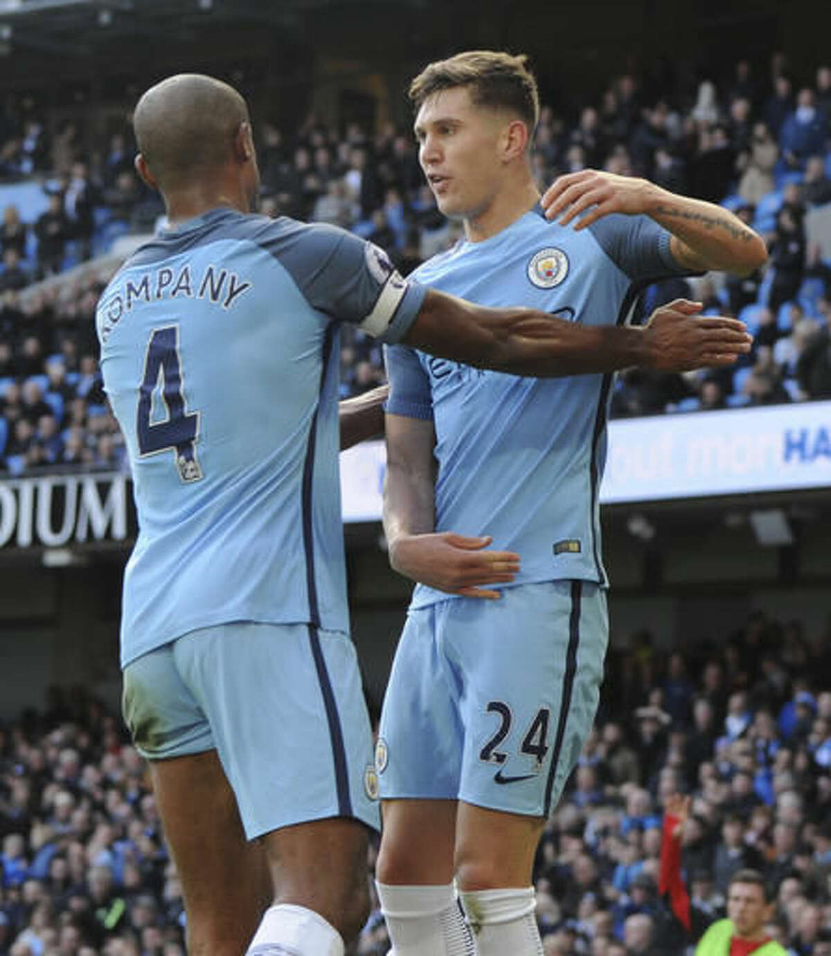 Manchester City's John Stones, right, celebrates with Manchester City's Vincent Kompany before his goal was disallowed for offside, during the English Premier League soccer match between Manchester City and Southampton at the Etihad Stadium in Manchester, England, Sunday, Oct. 23, 2016. (AP Photo/Rui Vieira)