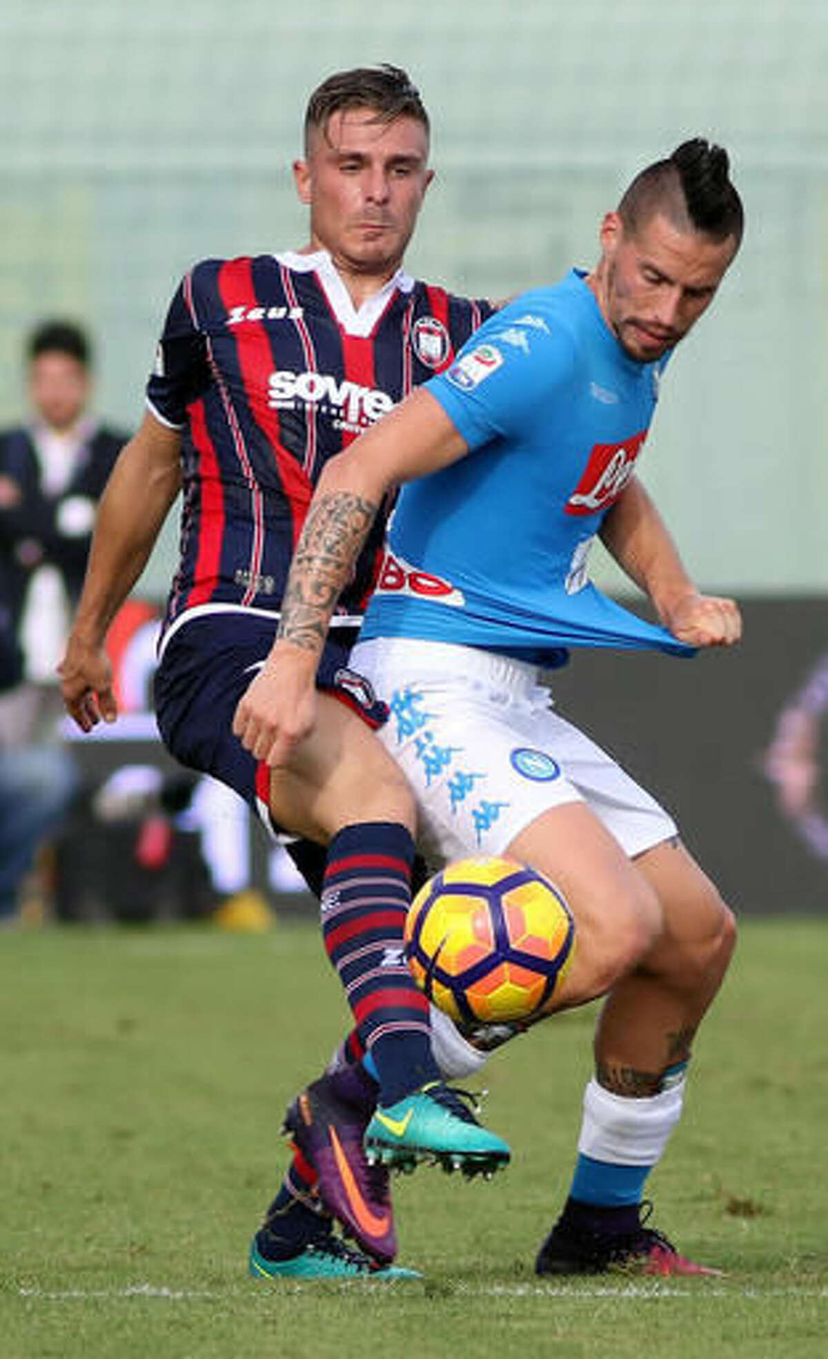 Napoli's Marek Hamsik, right, is challenged during a Serie A soccer match between Crotone and Napoli, in Crotone, Italy, Sunday, Oct. 23,2016. (Albano Anigilletta/ANSA via AP)