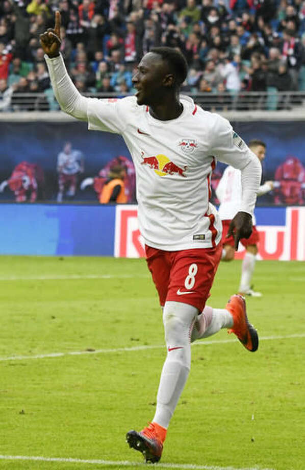 Leipzig's Naby Keita celebrates after scoring his second goal during the German first division Bundesliga soccer match between RB Leipzig and SV Werder Bremen in Leipzig, Germany, Sunday, Oct. 23, 2016. (AP Photo/Jens Meyer)