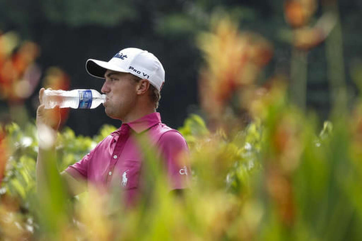 Justin Thomas of the United States rehydrates on the second hole during the final round of the CIMB Classic golf tournament at Tournament Players Club (TPC) in Kuala Lumpur, Malaysia, Sunday, Oct. 23, 2016. (AP Photo/Joshua Paul)