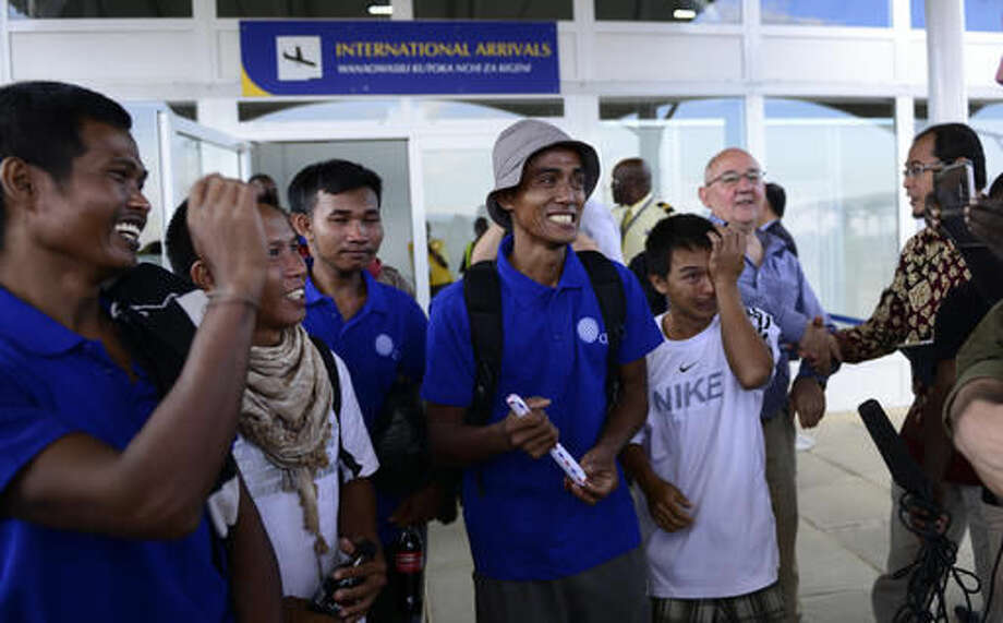 """Sailors who had been held hostage by pirates for more than four years, and were released in Somalia on Saturday, smile as they arrive at the airport in Nairobi, Kenya Sunday, Oct. 23, 2016. A Somali pirate said Saturday that 26 Asian sailors held hostage for more than four years had been released after a ransom was paid, and international mediators said it """"represents the end of captivity for the last remaining seafarers taken hostage during the height of Somali piracy."""" (AP Photo)"""