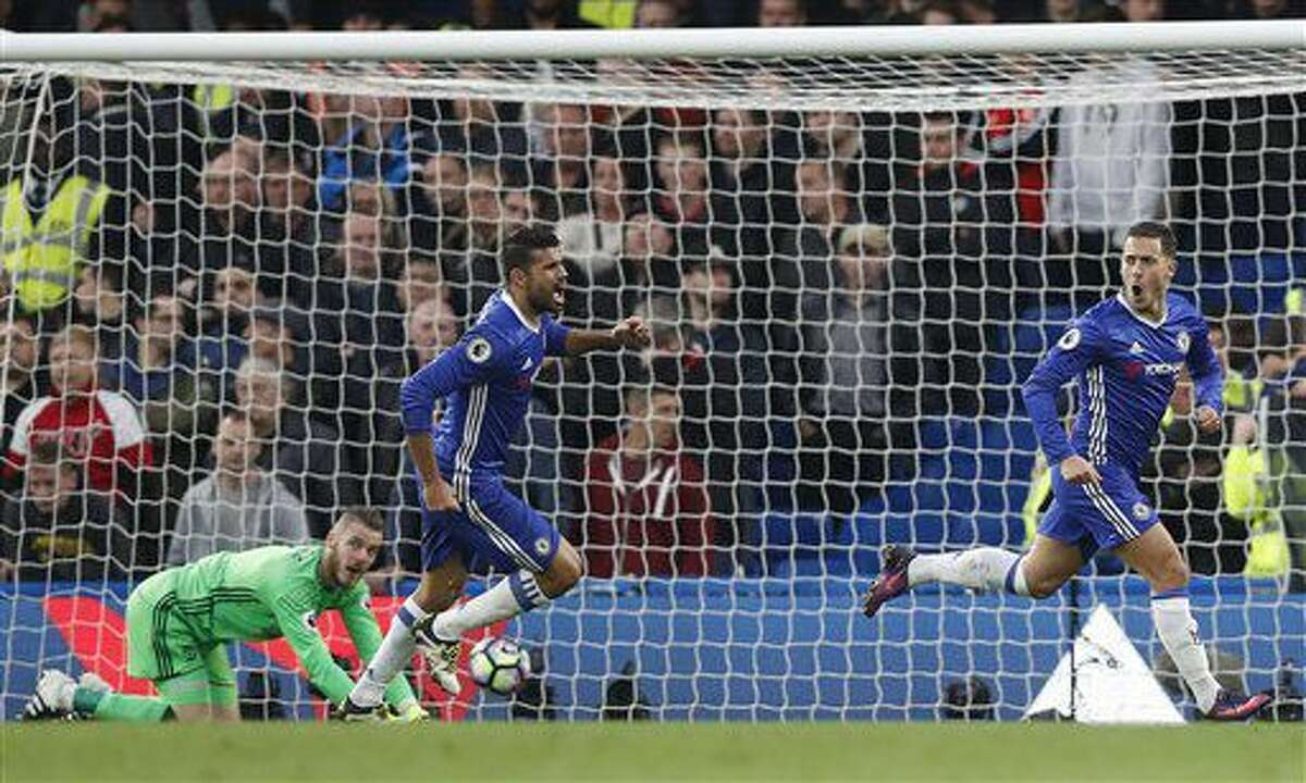 Chelsea's Eden Hazard, right, celebrates after scoring during the English Premier League soccer match between Chelsea and Manchester United at Stamford Bridge stadium in London, Sunday, Oct. 23, 2016.(AP Photo/Kirsty Wigglesworth)