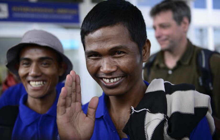 """Sailors who had been held hostage by pirates for more than four years, smile as they arrive at the airport in Nairobi, Kenya Sunday, Oct. 23, 2016, after being released in Somalia on Saturday. A Somali pirate said Saturday that 26 Asian sailors held hostage for more than four years had been released after a ransom was paid, and international mediators said it """"represents the end of captivity for the last remaining seafarers taken hostage during the height of Somali piracy."""" (AP Photo)"""