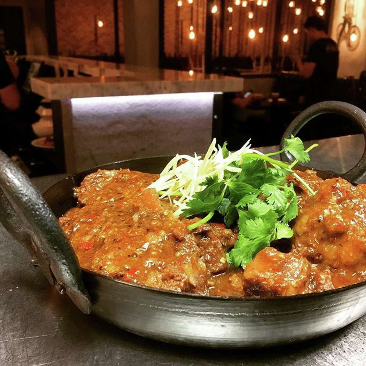 Night Market, a new curry and grill restaurant, is set to open Dec. 6 at 9630 Clarewood in Chinatown. This is a new concept from restaurateur Mike Tran (Tiger Den, Mein) who is working with chef Rikesh Patel. Shown: masala oxtail.