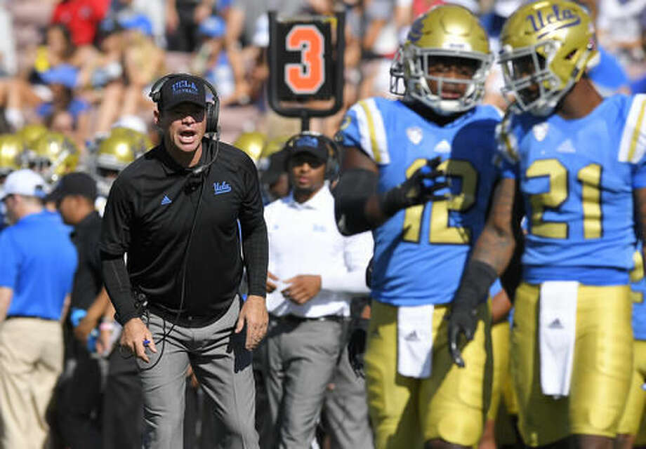 UCLA head coach Jim Mora, left, yells to linebacker Jayon Brown, center, and defensive back Tahaan Goodman during the first half of an NCAA college football game against Utah, Saturday, Oct. 22, 2016, in Pasadena, Calif. (AP Photo/Mark J. Terrill)