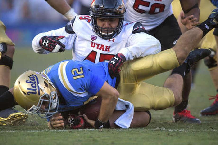 Utah defensive tackle Filipo Mokofisi, top, sacks UCLA quarterback Mike Fafaul during the second half of an NCAA college football game, Saturday, Oct. 22, 2016, in Pasadena, Calif. Utah won 52-45. (AP Photo/Mark J. Terrill)