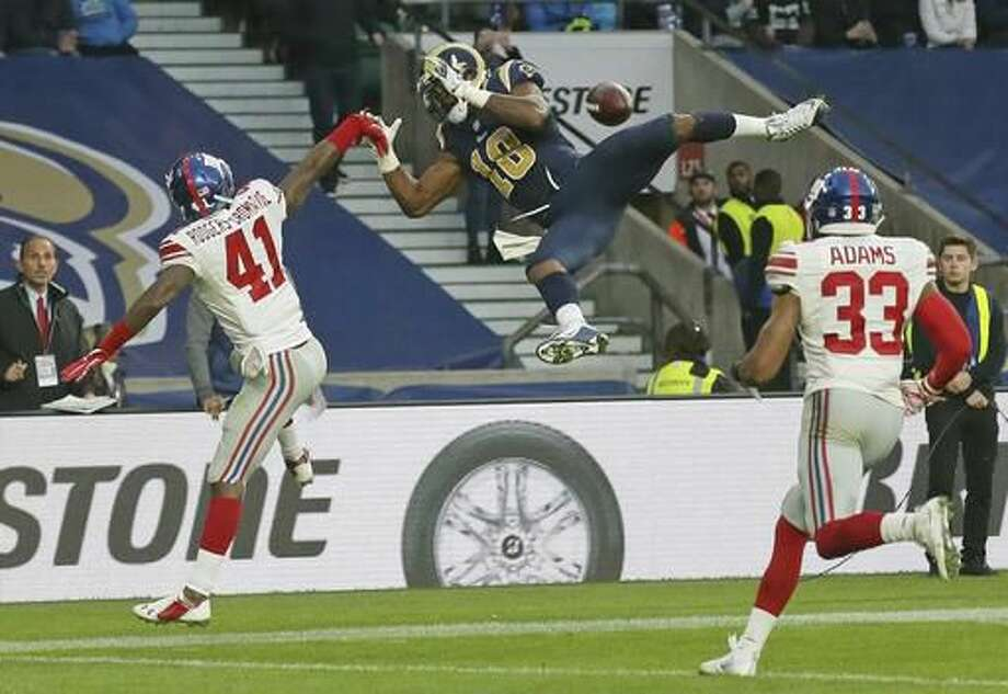 Los Angeles Rams wide receiver Kenny Britt (18) drops the ball under a challenge from New York Giants cornerback Dominique Rodgers-Cromartie (41) during an NFL football game at Twickenham stadium in London, Sunday Oct. 23, 2016. (AP Photo/Tim Ireland)