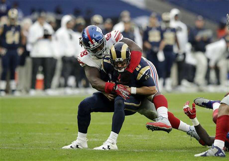 New York Giants defensive tackle Damon Harrison (98) tackles Los Angeles Rams quarterback Case Keenum (17) during an NFL football game between New York Giants and Los Angeles Rams at Twickenham stadium in London, Sunday Oct. 23, 2016. (AP Photo/Matt Dunham)