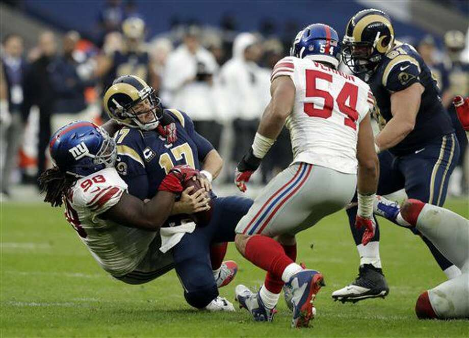New York Giants defensive tackle Damon Harrison (98) tackles Los Angeles Rams quarterback Case Keenum (17) during an NFL football game between New York Giants and Los Angeles Rams at Twickenham stadium in London, Sunday Oct. 23, 2016. (AP Photo/Matt Dunham)