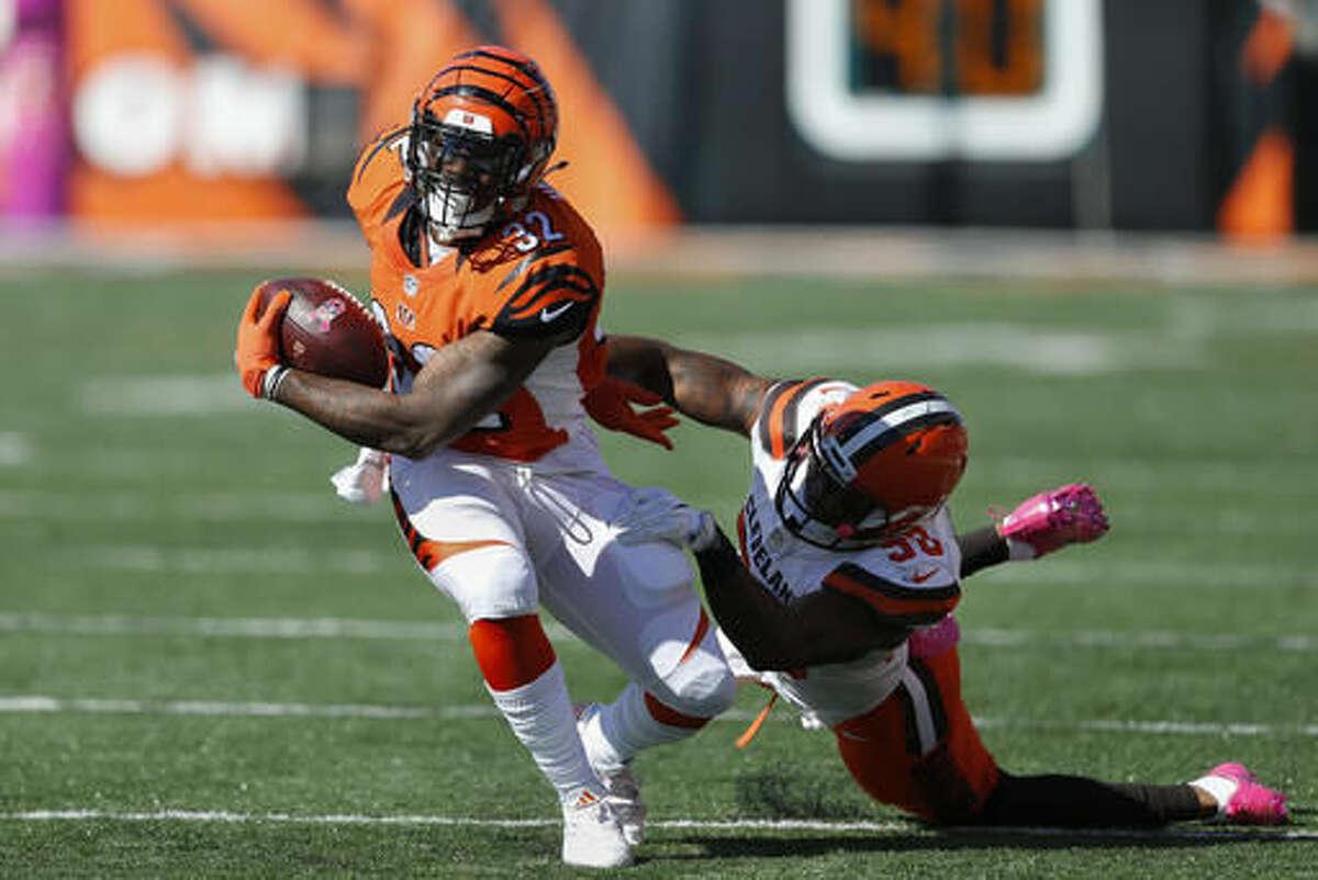 Cincinnati Bengals running back Jeremy Hill (32) breaks away from Cleveland Browns inside linebacker Chris Kirksey (58) in the first half of an NFL football game, Sunday, Oct. 23, 2016, in Cincinnati. (AP Photo/Gary Landers)