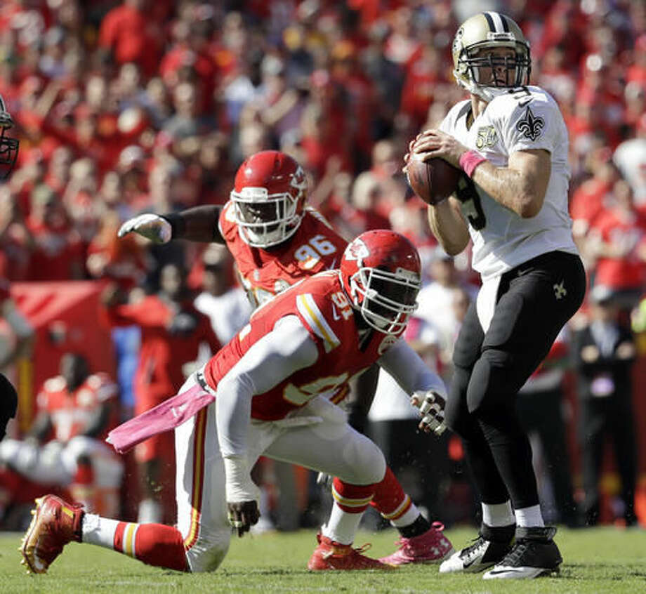 New Orleans Saints quarterback Drew Brees (9) looks for a receiver as Kansas City Chiefs linebacker Tamba Hali (91) closes in during the second half of an NFL football game in Kansas City, Mo., Sunday, Oct. 23, 2016. (AP Photo/Jeff Roberson)