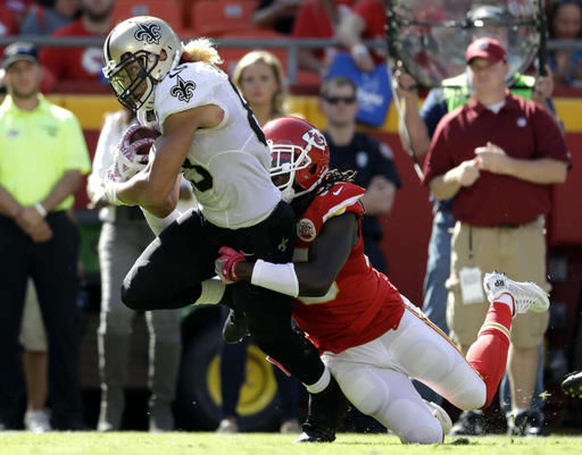 New Orleans Saints wide receiver Willie Snead IV (83) is tackled by Kansas City Chiefs defensive back Ron Parker, right, during the second half of an NFL football game in Kansas City, Mo., Sunday, Oct. 23, 2016. (AP Photo/Jeff Roberson)