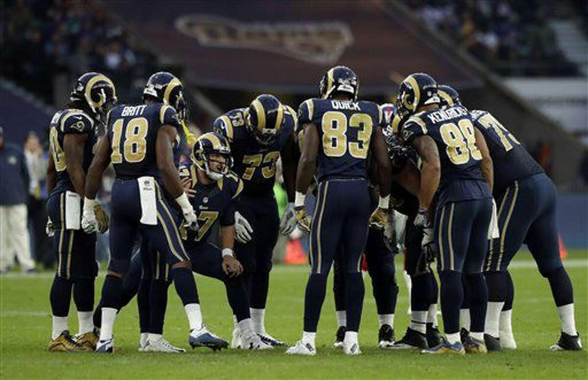 Los Angeles Rams players form a huddle in between plays during an NFL football game between New York Giants and Los Angeles Rams at Twickenham stadium in London, Sunday Oct. 23, 2016. (AP Photo/Matt Dunham)