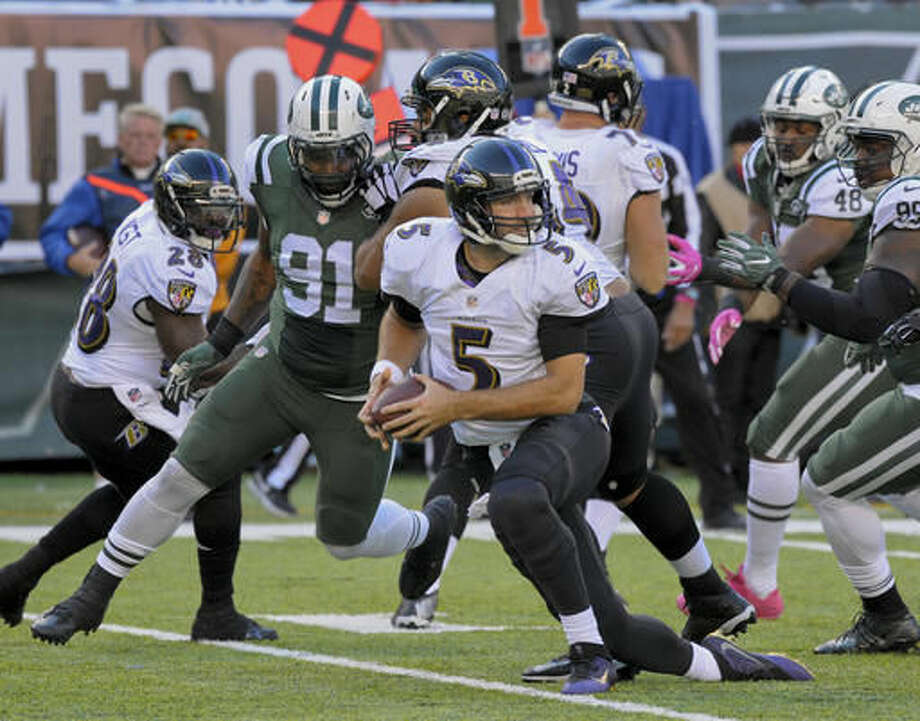 Baltimore Ravens quarterback Joe Flacco (5) looks to pass against the New York Jets during the fourth quarter of an NFL football game, Sunday, Oct. 23, 2016, in East Rutherford, N.J. (AP Photo/Bill Kostroun)