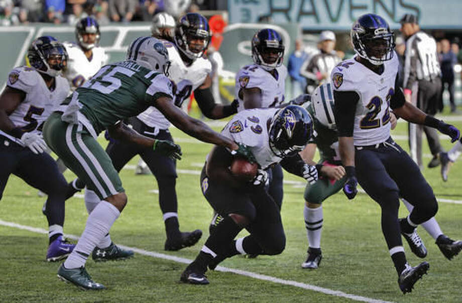 New York Jets wide receiver Brandon Marshall (15) strips the ball from Baltimore Ravens defensive end Timmy Jernigan (99) during the third quarter of an NFL football game, Sunday, Oct. 23, 2016, in East Rutherford, N.J. The Jets recovered the fumble. (AP Photo/Frank Franklin II)