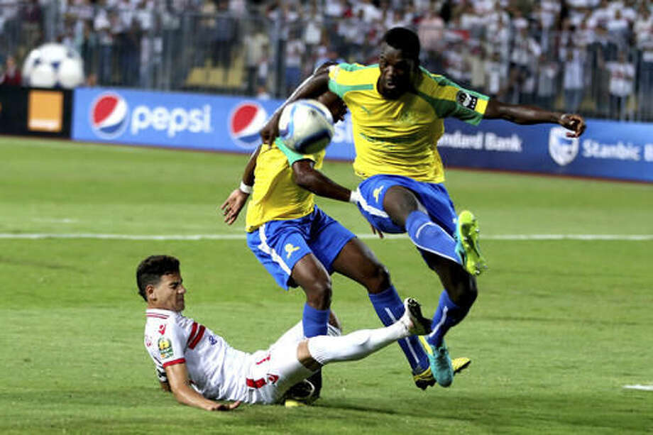 Al Zamalek's Ahmed Tawfik, left, fights for the ball during the CAF Champions League Final second leg soccer match between Al Zamalek and Mamelodi Sundowns, at the Borg El Arab Stadium in Alexandria, Egypt, Sunday, Oct. 23, 2016. (AP Photo/Ahmed Gamil)