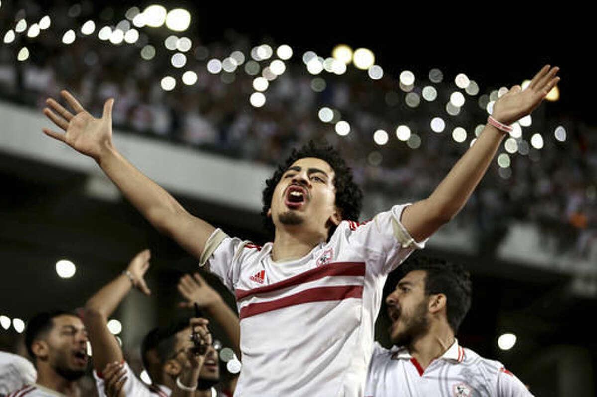 Al Zamalek fans cheer before the CAF Champions League Final second leg soccer match between Al Zamalek and Mamelodi Sundowns at the Borg El Arab Stadium in Alexandria, Egypt, Sunday, Oct. 23, 2016. (AP Photo/Ahmed Gamil)