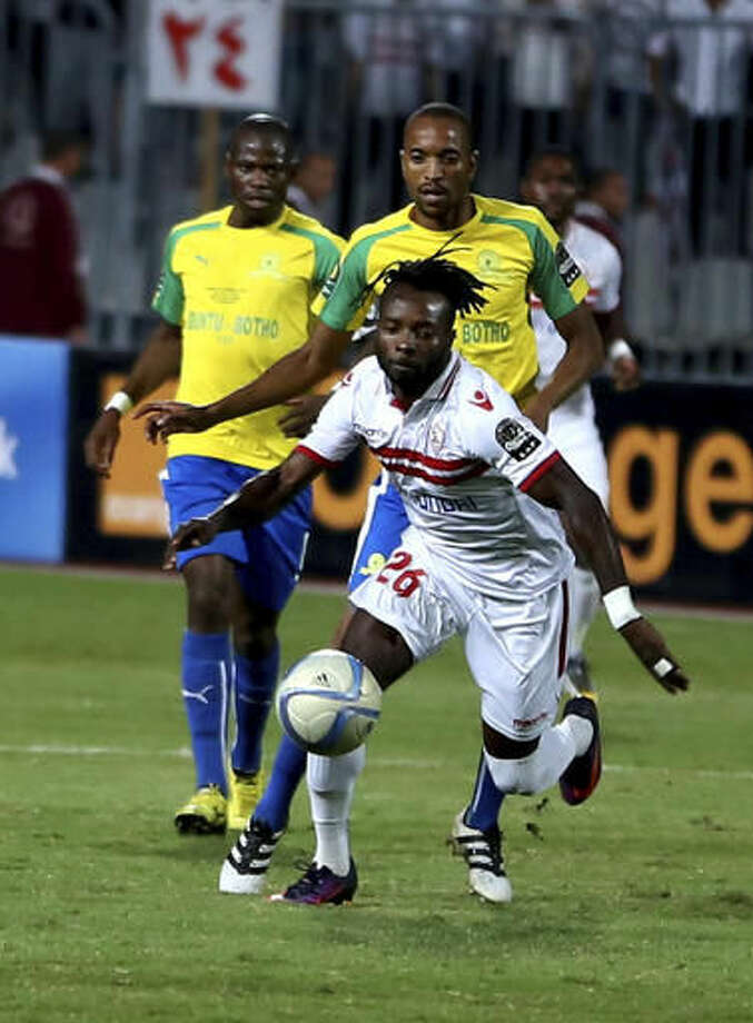 Al Zamalek's Stanley Nka Ohawuchi, center, fights for the ball against Mamelodi Sundowns player Tebogo Langerman, right, during the CAF Champions League Final second leg soccer match at the Borg El Arab Stadium in Alexandria, Egypt, Sunday, Oct. 23, 2016. (AP Photo/Ahmed Gamil)