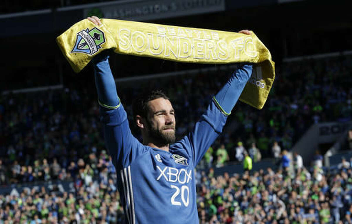 Seattle Sounders veteran defender Zach Scott is honored with the Golden Scarf Award before an MLS soccer match against Real Salt Lake, Sunday, Oct. 23, 2016, in Seattle. Scott is retiring at the end of the 2016 season. (AP Photo/Ted S. Warren)