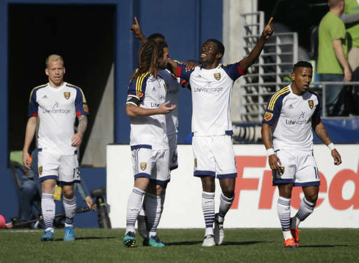 Real Salt Lake midfielder Sunday Stephen, second from right, celebrates with Kyle Beckerman, second from left, and Joao Plata, right, after Luke Mulholland, left, scored a goal against the Seattle Sounders, Sunday, Oct. 23, 2016, in the first half of an MLS soccer match in Seattle. (AP Photo/Ted S. Warren)