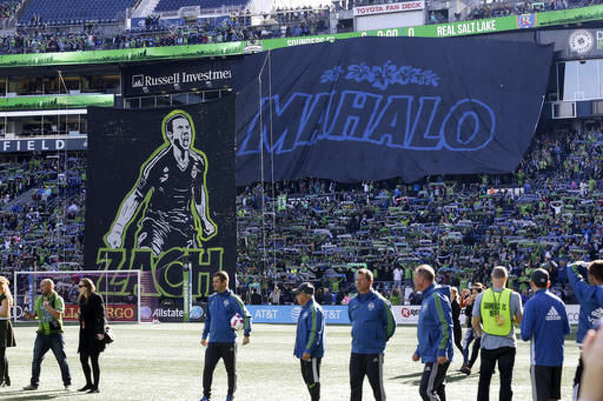 Seattle Sounders supporters display a Hawaiian-themed tifo display to honor veteran defender Zach Scott before an MLS soccer match against Real Salt Lake, Sunday, Oct. 23, 2016, in Seattle. Scott is retiring at the end of the 2016 season. (AP Photo/Ted S. Warren)