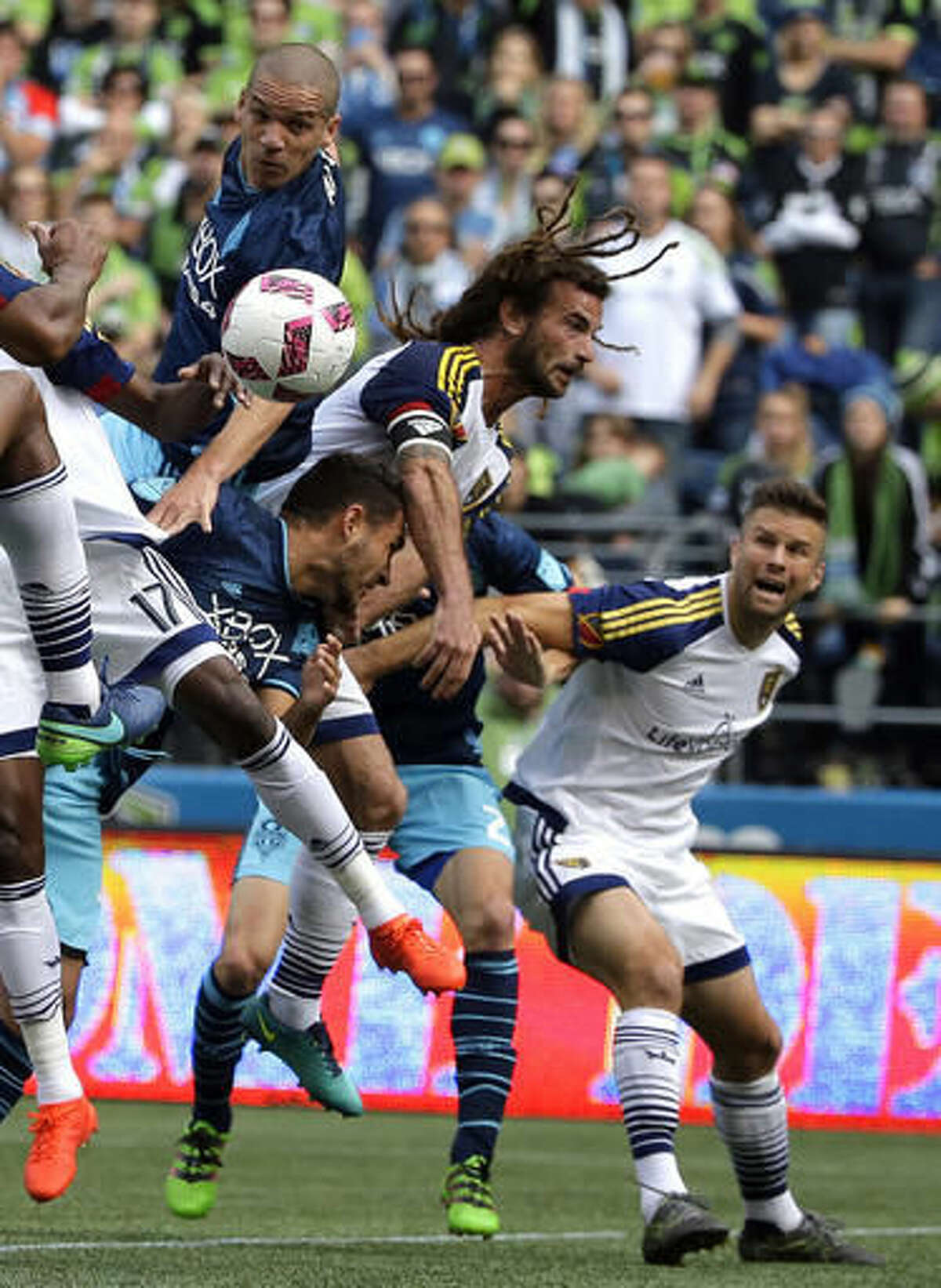 Seattle Sounders midfielder Osvaldo Alonso, upper left, and Real Salt Lake midfielder Kyle Beckerman, upper right, battle for the ball, Sunday, Oct. 23, 2016, in the first half of an MLS soccer match in Seattle. (AP Photo/Ted S. Warren)