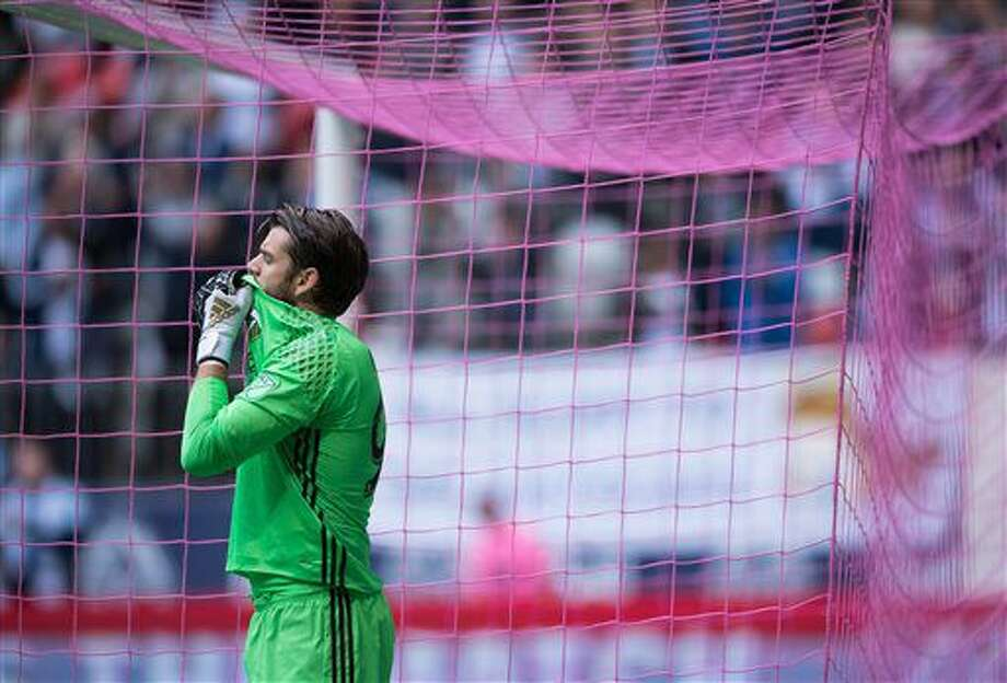 Portland Timbers' goalkeeper Jake Gleeson wipes his face after allowing a goal to Vancouver Whitecaps' Giles Barnes during the first half of an MLS soccer game in Vancouver, British Columbia, on Sunday Oct. 23, 2016. (Darryl Dyck/The Canadian Press via AP)