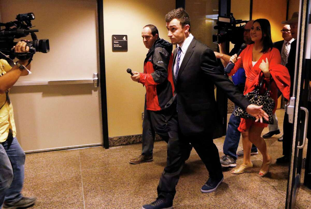 Johnny Manziel leaves the Frank Crowley Courts Building on Thursday, Nov. 17, 2016 after prosecutors said in court they have reached a tentative deal with his defense team to dismiss a misdemeanor assault charge against him. (David Woo/Dallas Morning News/TNS) NO MAGAZINE SALES; MANDATORY CREDIT; NO SALES; INTERNET USE BY TNS CONTRIBUTORS ONLY