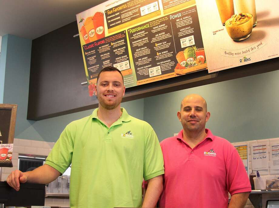 Pat Kovac and Mark Henques, owners of the Robeks franchise in Danbury, stand in their store at 109 Federal Road on Thursday, Dec. 1, 2016. Photo: Chris Bosak / Hearst Connecticut Media / The News-Times