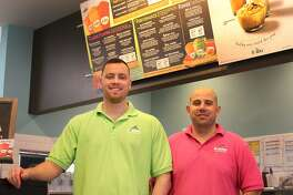 Pat Kovac and Mark Henques, owners of the Robeks franchise in Danbury, stand in their store at 109 Federal Road on Thursday, Dec. 1, 2016.