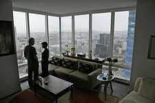 In this photo taken Monday, Oct. 3, 2016, Jerry Dodson and his wife Pat stand inside their home on the 42nd floor of the Millennium Tower in San Francisco. The 58-story tower has gained notoriety in recent weeks as the leaning tower of San Francisco. The Dodson's fear their investments are sinking along with the tower, and more immediately fear for their safety. (AP Photo/Eric Risberg)