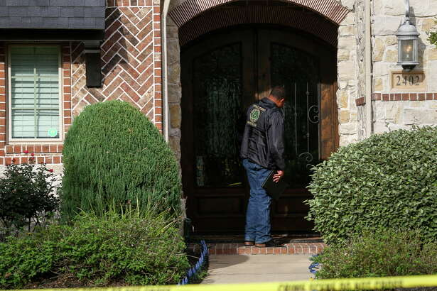 An investigator with the Fort Bend County District Attorney's office investigates a fatal shooting, in the 2400 block of Brandyshire Dr., Friday, Dec. 2, 2016, in Katy.