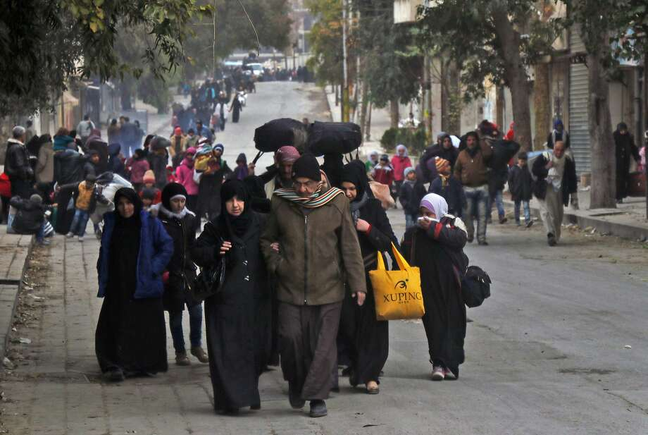 Syrian residents of eastern rebel-held parts of Aleppo leave their homes, searching for a safer place. Photo: THAER MOHAMMED, AFP/Getty Images