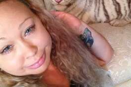 Trisha Meyer poses for a selfie with a white tiger. Meyer has been accused with child endangerment. ( Photo provided by Trisha Meyer )