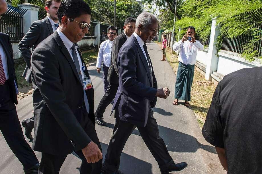 Former U.N. Secretary-General Kofi Annan (center), who heads a nine-member advisory commission on Myanmar's Rakhine state, heads to a meeting with Rakhine and Muslim representatives in Yangon. Photo: ROMEO GACAD, AFP/Getty Images