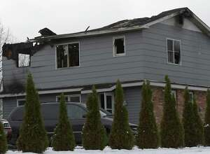 The house at 33 Clinton Court sustained severe damage from an early morning fire on Monday, Nov. 21, 2016, in Stillwater, N.Y. (Skip Dickstein/Times Union)
