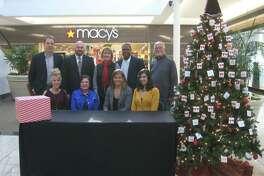 The following business stepped up to help the Empty Stocking Day Drive be a success - Minuteman Press of Humble, Deerbrook Mall, Macy's, Keller Williams Realty Northeast, the Humble Independent School District, Walgreen's, Memorial Hermann Northeast Hospital and Insperity and were on hand for a photo opportunity.