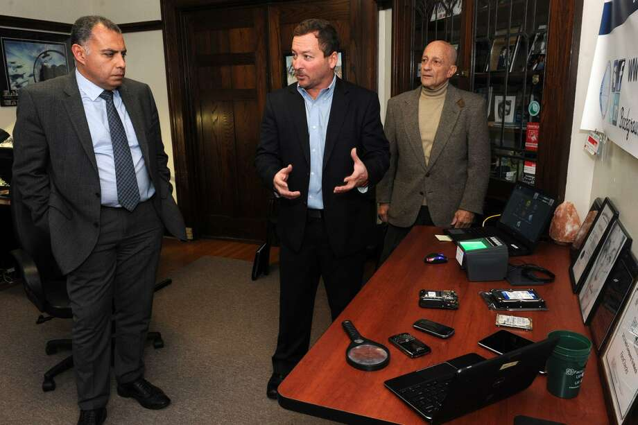 Al Dressler, Chief Executive Officer of FaceChecks, speaks in the Central Forensic Lab at the University of Bridgeport, in Bridgeport, Conn. Nov. 30, 2016. Dressler is seen here with Tarek Sobh, Dean of the university's School of Engineering, left, and Gad Selig, Dean for Industrial Outreach for the School of Engineering. Photo: Ned Gerard / Hearst Connecticut Media / Connecticut Post