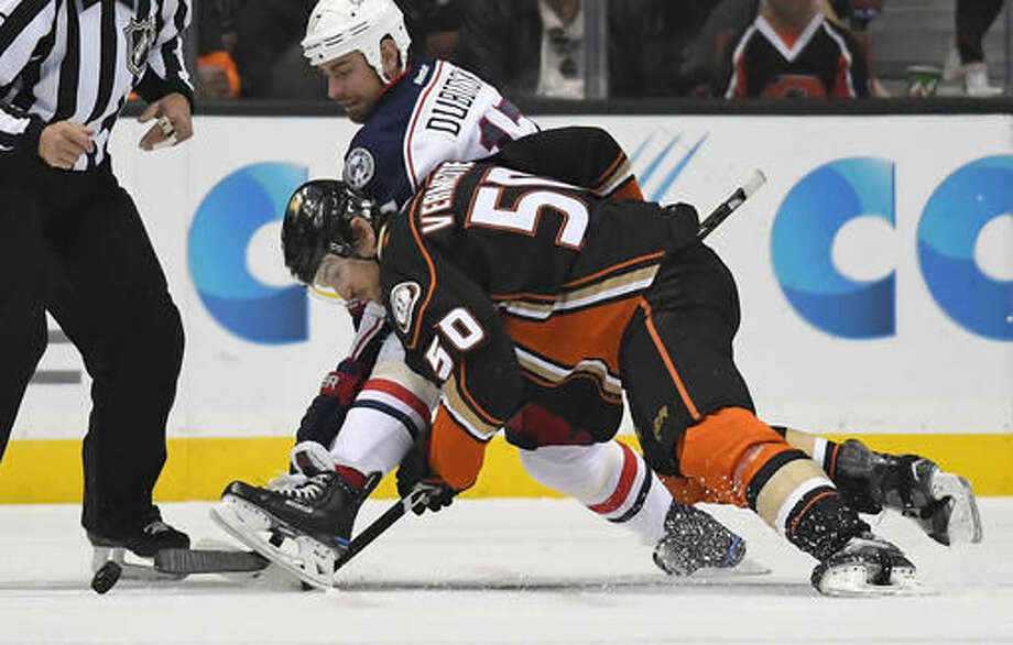 Columbus Blue Jackets center Brandon Dubinsky, top, and Anaheim Ducks center Antoine Vermette vie for the puck during the first period of an NHL hockey game, Friday, Oct. 28, 2016, in Anaheim, Calif. (AP Photo/Mark J. Terrill)