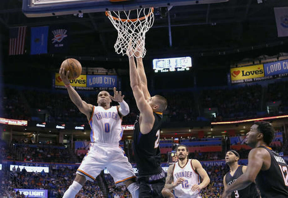 Oklahoma City Thunder guard Russell Westbrook (0) goes up for a basket as Phoenix Suns center Alex Len (21) defends during the second half of an NBA basketball game in Oklahoma City, Friday, Oct. 28, 2016. Oklahoma City won 113-110. (AP Photo/Alonzo Adams)